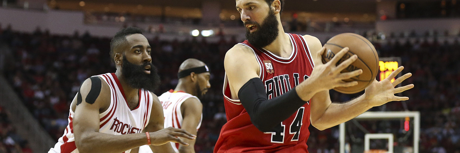 The Bulls rallied to beat the Rockets and keep their slim playoff hopes alive.